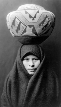 Zuni girl with jar