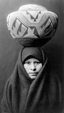 Zuni-girl-with-jar2.png