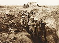 """Gas."" Australian troops with respirators on posed for the camera in the advance trench, Garter Point, 4th Division.jpg"