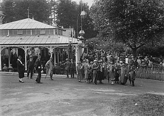 A gathering of people at the Rock Park Pump House, Llandrindod