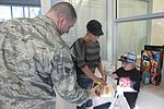 163d MXS delivers holiday cheer 121214-F-UF872-005.jpg