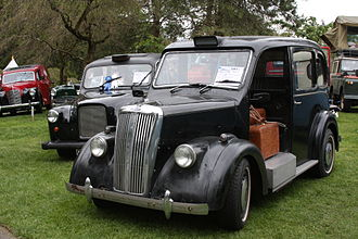 Hackney carriage - Until the late 1950s, vehicles licensed as London taxis were required to be provided with an open-access luggage platform in place of the front passenger seat found on other passenger cars (including taxis licensed for use in other British cities).
