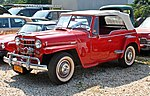 1950 Willys Jeepster in red (Montauk Fire Commissioner), front left.jpg