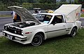 1977 AMC Hornet AMX with camping tent, front left.jpg