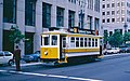 1983 SF Historic Trolley Festival - Porto car 122 on Market St at First.jpg