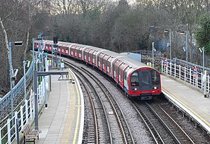 Roding Valley tube station - Train arrives on a Hainault-bound service