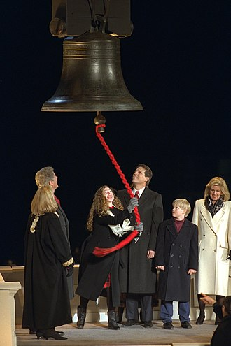 Chelsea Clinton - Clinton ringing a replica of the Liberty Bell at her father's first inauguration