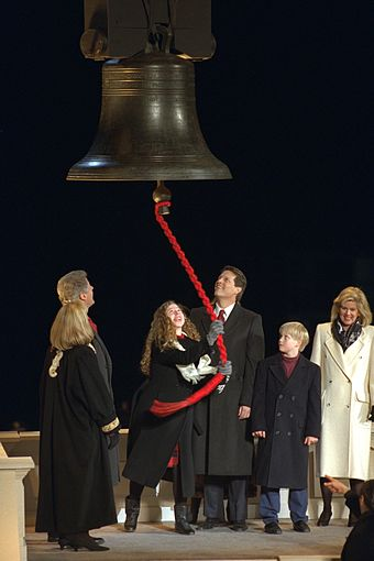 The Clintons and the Gores as Chelsea Clinton rings a replica of the Liberty Bell, 1993 1993 Clinton Inauguration.jpg