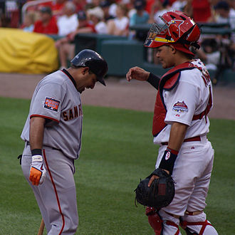 Yadier Molina - Molina interacting with his brother Bengie in a 2007 game, the first time they faced each other in the Major Leagues