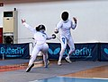 2nd Leonidas Pirgos Fencing Tournament. Nikoletta Chatzisarantou performs a lunge and scores a touch.jpg