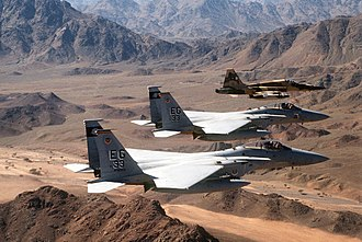 33rd Fighter Wing - An air-to-air view of two U.S. Air Force F-15C Eagle fighter aircraft from the 33rd Tactical Fighter Wing, Eglin Air Force Base, Florida, and a Royal Saudi Air Force F-5E Tiger II fighter aircraft during a Operation Desert Storm mission.