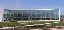 Picture of a modern office-like building with extensive glass facade.