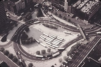Holland Tunnel - 1973 aerial view of rotary with parked buses. A fifth exit was added in 2004.