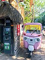 ATM and Bajaj RE Three Wheeler in Tulum (35745978223).jpg