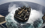 A U.S. Navy Landing Craft Air Cushion, more commonly known as an LCAC, exits the well deck of the amphibious assault ship USS Kearsarge (LHD 3) with a load of U.S. Marine Corps vehicles in the Arabian Sea 130411-N-AD372-171.jpg