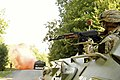 A Ukrainian Soldier looks for a the enemy from a BTR-80.jpg