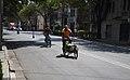 A cargo bike and a teen riding a bike in a pilot bus-bike lane in Mexico City.jpg