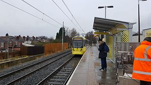 Abraham Moss tram stop - A M5000 arriving at Abraham Moss tram stop in January 2017.