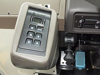Push-button gear selector in a 2010-2014 Mitsubishi Fuso Aero Star bus Aero Star MP37F Allison Shift selector and Parking brake lever.jpg