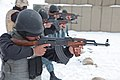 Afghan Uniformed Police officers fire their AK-47 assault rifles under the watch of Czech Military Police instructors, left, on Swanson Small Arms Range during training at Forward Operating Base Shank, Logar 120201-A-BZ540-034.jpg
