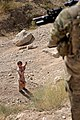 Afghan boy and an American soldier 110823-F-FT240-044.jpg