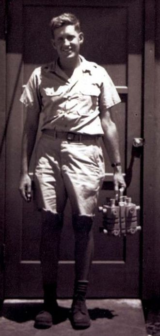 Harold Agnew - Harold Agnew on Tinian in 1945, carrying the plutonium core of the Nagasaki Fat Man bomb
