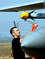 Airman 1st Class AJ McGee removes the raydome cover off an AIM-9X Sidewinder on an F-15C Eagle prior to takeoff.JPG