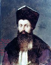 Portrait of a bearded man with a hat