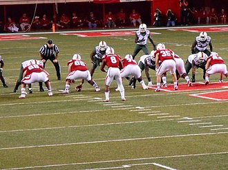 2014 Nebraska Cornhuskers football team - Ameer Abdullah about to receive a snap from center.
