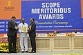 Anant Geete presenting the Meritorious Award at the SCOPE Meritorious presenting ceremony, in New Delhi. The President, Shri Pranab Mukherjee and the Minister of State for Heavy Industries and Public Enterprises.jpg