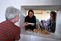 Ariane Hiriart passes a student's plate of food (4510648431).jpg