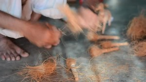 File:Artisan making a coir toy.webm