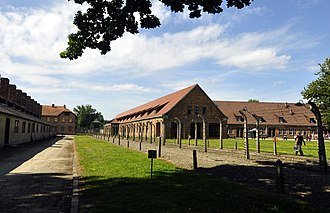 Auschwitz concentration camp - Former prisoner reception centre; the building on the far left with the row of chimneys was the camp kitchen.