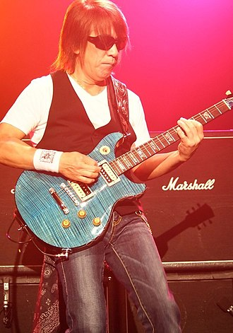 Tak Matsumoto - Matsumoto performing in 2012