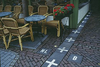 Sidewalk cafe - Sidewalk cafe in Baarle-Nassau. The marks show the border between the Netherlands (NL) and Belgium (B).