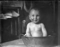 Baby in a metal bath tub ATLIB 307578.png