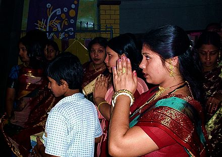 Shakta Hindus in Dhaka, Bangladesh, pray to the goddess during Durga Puja, October 2003 Bangladesh Prayer.jpg
