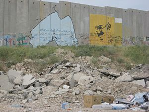 Graffiti paintings on the Israeli West Bank ba...