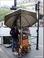 Barrel organist Paris (5699893192).jpg