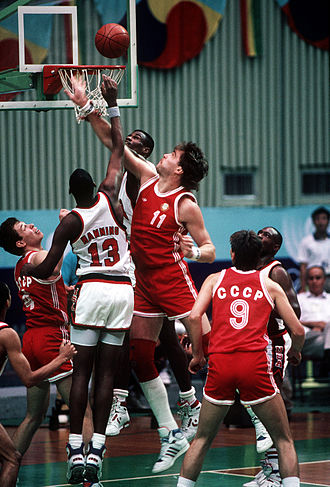 Arvydas Sabonis - Sabonis, a member of the Soviet Union national team, taking on David Robinson and Danny Manning, during the semifinal clash with Team USA, at the 1988 Olympics. The Soviets scored an 82–76 win, with Sabonis contributing 13 points and 13 rebounds.