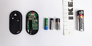 A27 battery - Two A27 batteries, with an A23 and an AA battery for comparison, and a remote control using this type of battery.