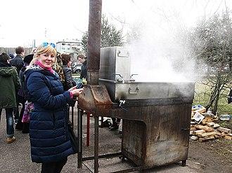 Birch syrup - Birch sap Festival, Russia. Evaporation of birch sap into birch syrup