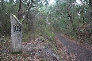 Crowes railway line - Cutting and 103 mile (166 km) post on the line