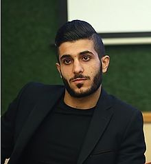 Behnam Barzay in press conference.jpg