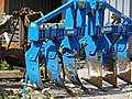 Blue plow, parked near the barn on the yard, in Laaghalerveen, Drenthe, the Netherlands 2012.jpg