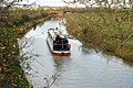 Boat heading north between bridges 82 and 81, Oxford Canal - geograph.org.uk - 1566613.jpg