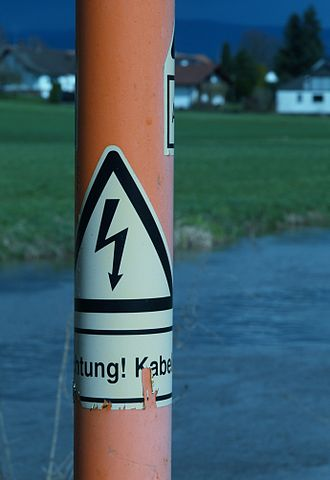 Undergrounding - An underground cable marker. Markers are put at regular intervals to show the route and warn of the hazard of digging into the cable.