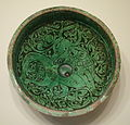 Bowl with prancing quadruped, Iran, Garrus district, Seljuk period, 12th or 13th century AD, earthenware with carved slip design under green glaze - Cincinnati Art Museum - DSC03988.JPG