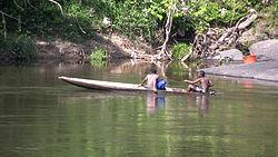 Boys in a canoe on the Gran Rio river.jpg