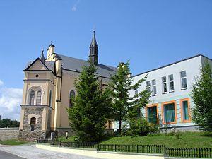 Bukowsko - Main street in Bukowsko, Catholic Church and city bank.